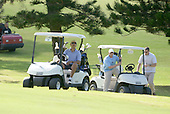 United States President Barack Obama drives a golf cart approaching the 18th hole as he and friends Marvin Nicholson, Bobby Titcomb, left, and Eric Whitaker enjoy a round of golf at Mid Pacific Country Club, Kailua, Hawaii on Monday, December 23, 2013.  The first family is enjoying holiday vacation in Hawaii until January 5, 2014. <br /> Credit: Cory Lum / Pool via CNP
