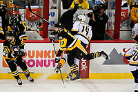 May 29, 2017: Pittsburgh Penguins center Nick Bonino (13) checks Nashville Predators defenseman Mattias Ekholm (14) into the boards causing NBC commentator Pierre McGuire to jump out of the way during game one of the National Hockey League Stanley Cup Finals between the Nashville Predators  and the Pittsburgh Penguins, held at PPG Paints Arena, in Pittsburgh, PA. Pittsburgh defeats Nashville 5-3 in regulation time.  Eric Canha/CSM