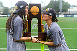 TAMPA, FL - MAY 20:  Sidney Hall #11 and Nicole Delany #17 of the Le Moyne Dolphins kiss the trophy after defeating the Florida Southern Mocs during the Division II Women's Lacrosse Championship held at the Naimoli Family Athletic and Intramural Complex on the University of Tampa campus on May 20, 2018 in Tampa, Florida. Le Moyne defeated Florida Southern 16-11 for the national title. (Photo by Jamie Schwaberow/NCAA Photos via Getty Images)