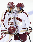 Blake Bolden (BC - 10), Melissa Bizzari (BC - 4) - The Boston College Eagles defeated the visiting Cornell University Big Red 4-3 (OT) on Sunday, January 11, 2012, at Kelley Rink in Conte Forum in Chestnut Hill, Massachusetts.