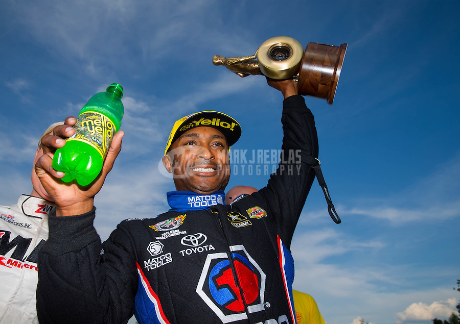 Sep 20, 2015; Concord, NC, USA; NHRA top fuel driver Antron Brown celebrates after winning the Carolina Nationals at zMax Dragway. Mandatory Credit: Mark J. Rebilas-USA TODAY Sports