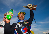 Sep 20, 2015; Concord, NC, USA; NHRA top fuel driver Antron Brown celebrates after winning the Carolina Nationals at zMax Dragway. Mandatory Credit: Mark J. Rebilas-USA TODAY Sports