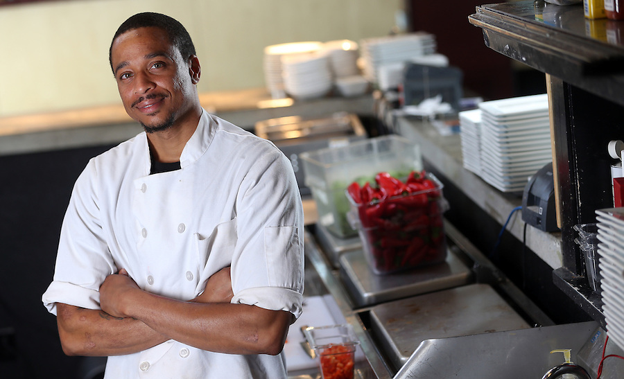 Devon Miller works in the kitchen at 3 Penny Restaurant located in Charlottesville, Va. Photo/Andrew Shurtleff