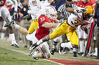 spt-asuua 112910226tmk --Arizona's Jake Fischer (CQ) tackles ASU's Jamal Miles during the fourth quarter of Thursday's Territorial Cup in Tucson.  (Pat Shannahan/ The Arizona Republic)
