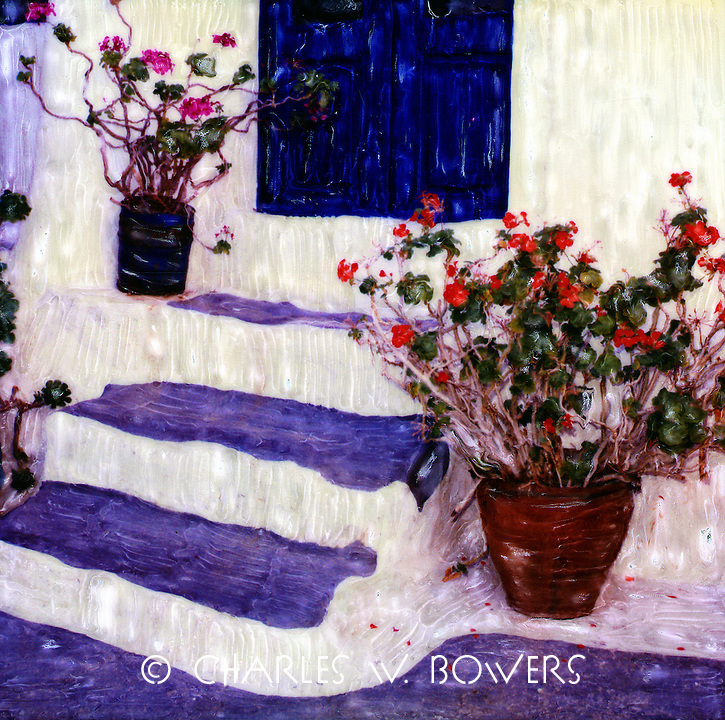 Geraniums flank the steps and door welcoming visits to our home. Geraniums are tough plants that serve us well.