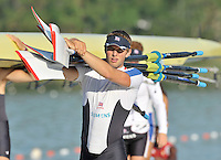 Banyoles, SPAIN, GBR M4X, Bill LUCAS, carrying the quads blades,  FISA World Cup Rd 1. Lake Banyoles  Saturday,  30/05/2009   [Mandatory Credit. Peter Spurrier/Intersport Images]