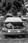 Child reading a comic in car boot. Eton College 4th of June Parents Day. England. 1978