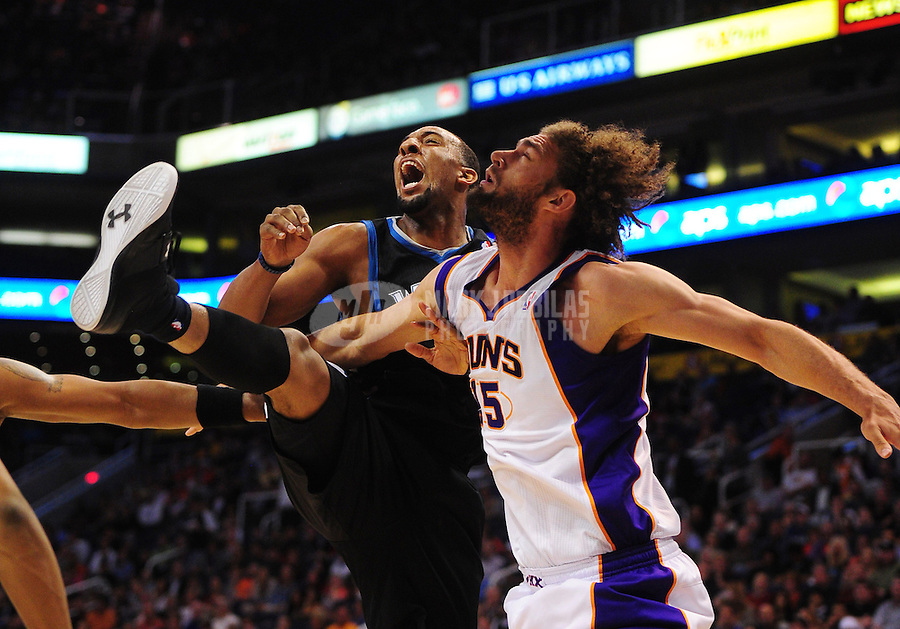 Mar. 1, 2012; Phoenix, AZ, USA; Minnesota Timberwolves forward Derrick Williams (left) and Phoenix Suns center Robin Lopez fight for position beneath the basket in the first half at the US Airways Center. The Suns defeated the Timberwolves 104-95. Mandatory Credit: Mark J. Rebilas-.