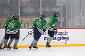 Notre Dame Fighting Irish of Batavia players Spencer Misiak (17), Cam Chamberlain (20) and Kris Bank (14) celebrate a goal during a varsity ice hockey game against the Brockport Blue Devils during the Section V Rivalry portion of the Frozen Frontier outdoor hockey event at Frontier Field on December 22, 2013 in Rochester, New York.  (Copyright Mike Janes Photography)