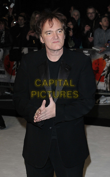 Quentin Tarantino.The UK Premiere of 'Django Unchained', Empire Leicester Square, London, England..January 10th 2013.half length black suit hands   .CAP/CAN.©Can Nguyen/Capital Pictures.