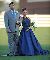 NWA Democrat-Gazette/ANDY SHUPE<br /> Class maids participate Friday, Sept. 25, 2015, in the coronation ceremony at Wildcat Stadium at Har-Ber High School in Springdale. Visit nwadg.com/photos to see more photographs from the ceremony.