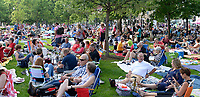 The crowd gathers on the Capitol lawn before Concerts on the Square on Wednesday, 6/27/18, in Madison