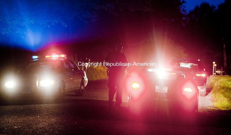 ROXBURY, CT-062014JS02--State Police blocked off the entrance of Carriage Lane in Roxbury on Thursday night as they investigate the an ATV accident that left and 11 year-old boy dead. <br />  Jim Shannon Republican-American