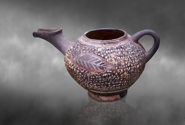 """Minoan Kamares Ware beak spouted """"teapot"""" with extended spout and  leaf polychrome decorations, Kamares Sacred Cave 1900-1700 BC; Heraklion Archaeological  Museum, grey background.<br /> <br /> This style of pottery is named afetr Kamares cave where this style of pottery was first found"""