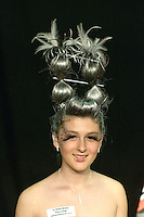 Competitors design their models to represent a country, a place or a concept in the annual X-Foto competition, Hair & Beauty Department at Kingston College, London.