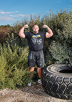 Brian Shaw (cq) trains for a strongman competition at Shaw's gym in Frederick, Colorado, Saturday, September 21, 2013. Shaw is the winner of the 2011 World's Strongest Man, 2013 World's Strongest Man and 2015 World's Strongest Man competitions.<br /> <br /> Photo by Matt Nager