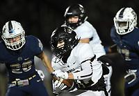NWA Democrat-Gazette/CHARLIE KAIJO Bentonville Cooper Smith (12) carries the ball, Friday, November 8, 2019 during a football game at Bentonville West High School in Centerton.