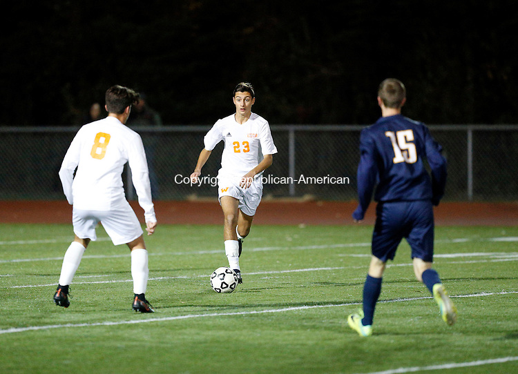 Watertown, CT- 10 November 2016-111016CM11-  Watertown's Anthony Longo (23) moves the ball towards teammate Valdet Nuredini (8) as RHAM's Jack Salan (15) defends during their state tournament matchup on Thursday.     Christopher Massa Republican-American