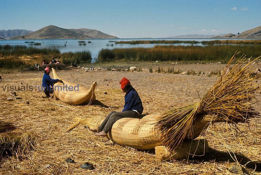 Aymara Indian fishermen making reed rafts called  balsa de totora, on Suriqui Island, Lake Titicaca, Bolivia