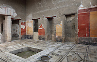 Atrium, with central impluvium or water tank, and mosaic floor with animals within black and white borders, 1st century AD, in the Casa di Paquio Proculo, or House of Paquius Proculus, Pompeii, Italy. The walls are decorated with red, yellow and black frescoes in the Fourth Style of Roman wall painting, 60-79 AD. Pompeii is a Roman town which was destroyed and buried under 4-6 m of volcanic ash in the eruption of Mount Vesuvius in 79 AD. Buildings and artefacts were preserved in the ash and have been excavated and restored. Pompeii is listed as a UNESCO World Heritage Site. Picture by Manuel Cohen