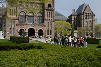 Toronto (ON) CANADA,  April , 2008-.A group of tourists approach TheOntario Legislature in Queens Park...urban park in the Downtown area of Toronto. Opened in 1860 by Edward, Prince of Wales, it was named in honour of Queen Victoria. The park is the site of the Ontario Legislature, which houses the Legislative Assembly of Ontario, and so the phrase Queen's Park is also frequently used to refer to the Government of Ontario....