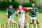 It's my ball<br /> --------------<br /> Kilcummin's Chris O'Leary bursts out from defence with a good grip of the ball as St Brendan's Michael Griffin gives chase, when the sides met in Blennerville last Saturday evening.