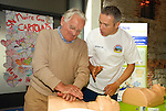 Dave Kiernan of the Boyne Fishermen's Rescue and Recovery Service shows Tony Lynn how to perfor CPR at teh BFRRS demonstration in Scotch Hall. www.newsfile.ie