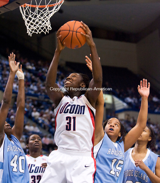 HARTFORD, CT - 22 NOVEMBER 2008 -112208JT05-<br /> UConn's Tina Charles attempts a layup before eventually getting fouled by Rhode Island's #40 Ebony Lewis during Saturday's game at the XL Center in Hartford. In the background is UConn's Kalana Greene, and to the right are Rhode Island's #15 Lindsay Harris and #30 Sierra Cooper. The Huskies won, 91-43. Charles was the highest scorer of the game with 21 points.<br /> Josalee Thrift / Republican-American