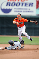 Erie Seawolves Shortstop Cale Iorg (7) turns a double play during a game vs. the Trenton Thunder at Jerry Uht Park in Erie, Pennsylvania;  June 24, 2010.   Trenton defeated Erie 11-2  Photo By Mike Janes/Four Seam Images
