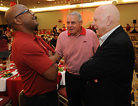 NWA Democrat-Gazette/ANDY SHUPE<br /> Quinn Grovey (from left), former Arkansas quarterback and current on-field voice of the football audio broadcasts, Ken Hatfield, former Arkansas player and football coach, and Dean Weber, former Arkansas athletic trainer and current assistant director of the Razorback Foundation, laugh Friday, Aug. 18, 2017, while speaking before the start of the Kickoff Luncheon at the Northwest Arkansas Convention Center in Springdale. Visit nwadg.com/photos to see more photographs from the luncheon.