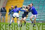 Kieran O'Leary of Dr Crokes and Sean Chaplin and Barry Duggan of Cratloe in the AIB Munster Senior Football Final played last Sunday in The Gaelic Grounds, Limerick.