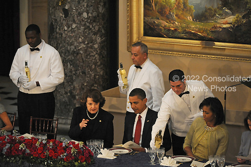 Washington, DC - January 20, 2009 -- United States Senator Diane Feinstein (Democrat of California), United States President Barack Obama and first lady Michelle Obama at the luncheon at Statuary Hall in the U.S. Capitol in Washington DC following Barack Obama's swearing in as the 44th President of the United States on January 20, 2009..Credit: Amanda Rivkin - Pool via CNP