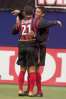 The MetroStars' Craig Ziadie celebrates with teammate  Amado Guevara after Guevara tied the score at one all in the 14 minute. The New England Revolution played the NY/NJ MetroStars to a 1 to 1 tie at Giant's Stadium, East Rutherford, NJ, on April 24, 2004.