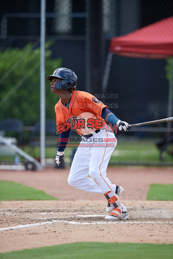 GCL Astros shortstop Freudis Nova (16) follows through on a swing during a game against the GCL Marlins on August 5, 2018 at FITTEAM Ballpark of the Palm Beaches in West Palm Beach, Florida.  GCL Astros defeated GCL Marlins 2-1.  (Mike Janes/Four Seam Images)