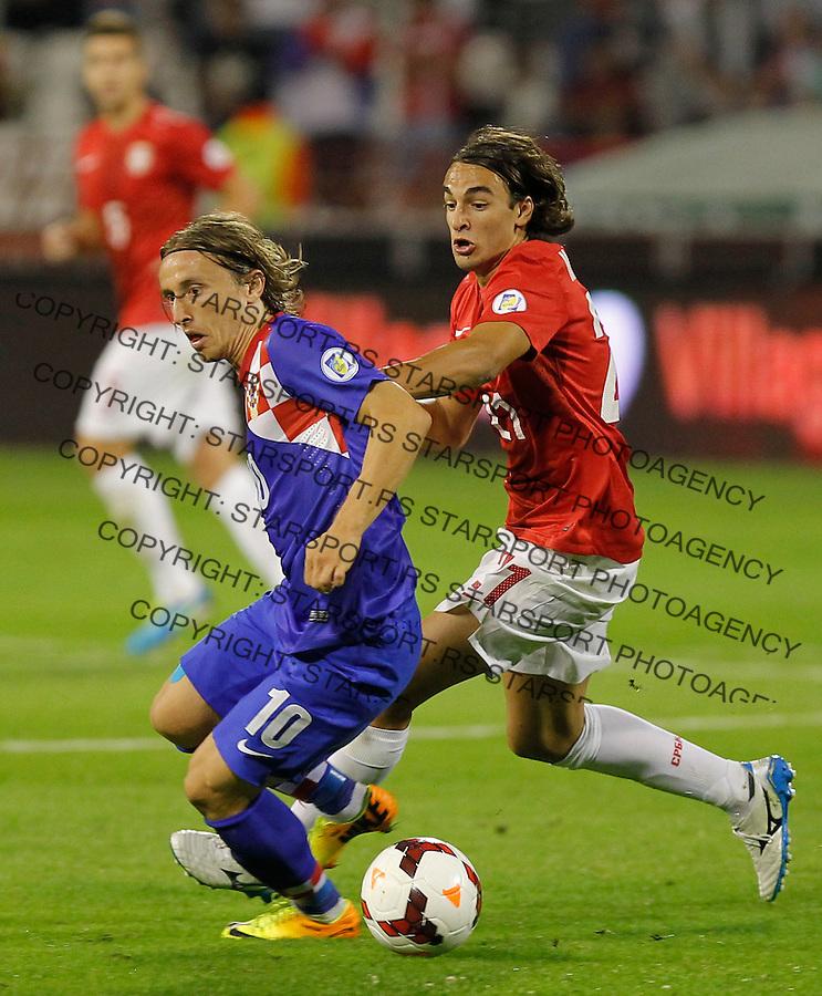 Fudbal Soccer<br /> World Cup 2014 qualifiers match<br /> Serbia v Croatia<br /> Luka Modric and Lazar Markovic (R)<br /> Beograd, 06.09.2013.<br /> foto: Srdjan Stevanovic/Starsportphoto &copy;
