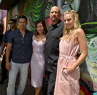 MIAMI, FL - JULY 25: Jay Hernandez, Karen Fukuhara, David Ayer and Margot Robbie attends the 'Suicide Squad' Wynwood Block Party and Mural Reveal with cast on July 25, 2016 in Miami, Florida.  Credit: MPI10 / MediaPunch