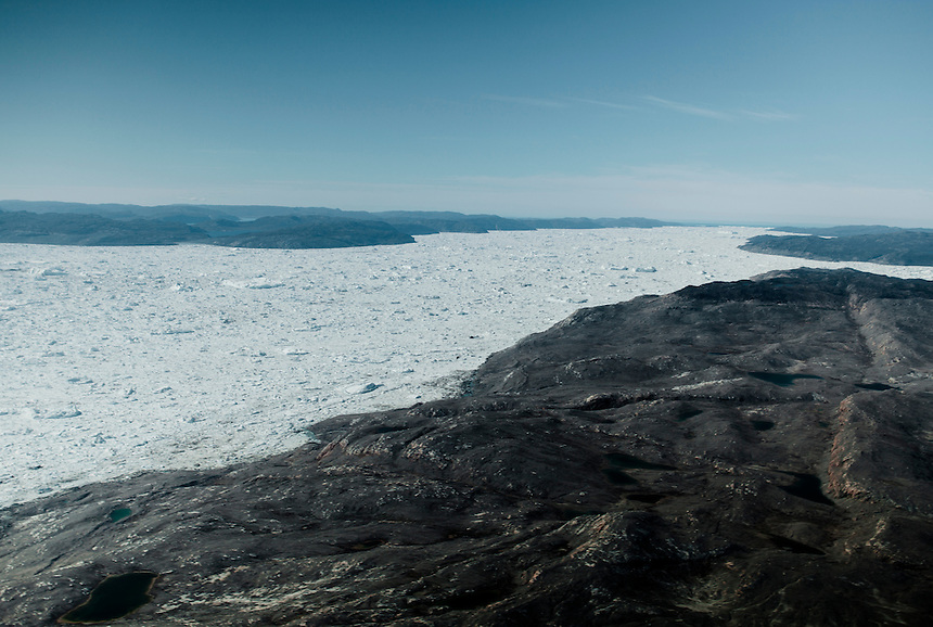 The Ilulissat ice fjord, stretching 45 kilometers to the ocean at the horizon, is seen from the window of a helicopter, West Greenland, August 2011. The Ilulissat ice fjord is a river of icebergs moving toward the sea after breaking off of the ice cap at the glacier's front - out of frame and to the left. Photo: Ed Giles.