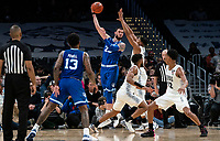 WASHINGTON, DC - FEBRUARY 05: Sandro Mamukelashvili #23 of Seton Hall sends  pass pver Jamorko Pickett #1 of Georgetown during a game between Seton Hall and Georgetown at Capital One Arena on February 05, 2020 in Washington, DC.