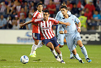 Isao Torres (50) Chivas Guadalajara holds off Milos Stojcev (88) Sporting KC... Sporting Kansas City and Chivas Guadalajara played to a 2-2 tie in an international friendly at LIVESTRONG Sporting Park, Kansas City, Kansas.