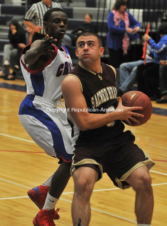 WATERBURY, CT 12 DECEMBER- 121212JS06-Sacred Heart's Zach Goldberg (3) drives to the basket past Crosby's Stephon Dunbar (21) during their game Wednesday at Crosby High School in Waterbury. .Jim Shannon Republican American
