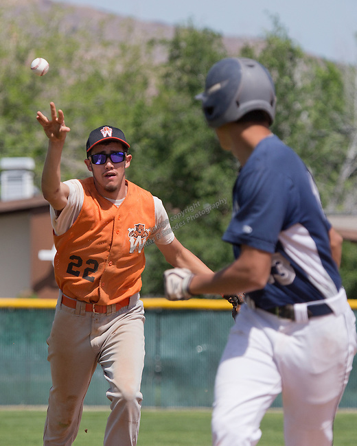 Wells shortstop Armando Soriano has Virginia City Carlos Robledo in a rundown in the championship of the NIAA Division IV State baseball tournament on Saturday, May 24, 2014 at Sparks High School.