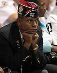 A member of the crowd listens to Presiden Barack Obama's speech at the 113th National Convention of the Veterans of Foreign Wars in Reno, Nev., on Monday, July 23, 2012..Photo by Cathleen Allison