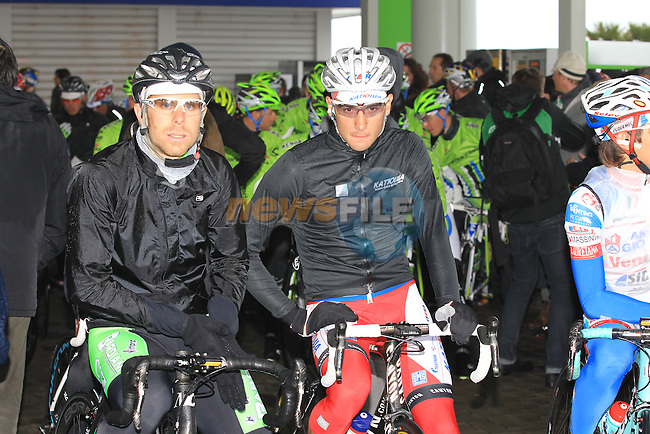 The reamaining riders take shelter in a forecourt as they wait for the race to restart in Cogoleto after heavy snow forces the race organizers to abandon part of the race over Passo del Turchino during the 104th edition of the Milan-San Remo cycle race, 17th March 2013 (Photo by Eoin Clarke 2013)