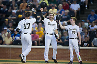 Bruce Steel (17) of the Wake Forest Demon Deacons bangs helmets with teammate Johnny Aiello (2) after hitting a 2-run home run against the West Virginia Mountaineers in Game Four of the Winston-Salem Regional in the 2017 College World Series at David F. Couch Ballpark on June 3, 2017 in Winston-Salem, North Carolina.  The Demon Deacons walked-off the Mountaineers 4-3.  (Brian Westerholt/Four Seam Images)