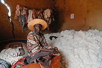 Africa BURKINA FASO fairtrade and organic cotton project , clay hut of farmer Boukoungou Wenneda of cooperative UNPCB in village Kayao near Ouagadougou with the cotton harvest and his bed