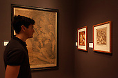 """Pictured: A man stands in front of the picture """"Lamentation of Christ"""", 1593 by Andrea Andreani (1558/59-1629) after Alessandro Casolani. Press preview of the exhibition """"Renaissance Impressions: Chiaroscuro Woodcuts from the Collections of Georg Baselitz and the Albertina, Vienna"""", opens at the Royal Academy of Art on 15 March 2014. The exhibition at the Sackler Wing of Galleries runs from 15 March to 8 June 2014 and presents over 150 rare prints by the chief practitioners of the Chiaroscuro woodcutting technique in Germany, Italy and the Netherlands held at the Albertina Museum in Vienna and in the personal collection of the Honorary Royal Academian Georg Baselitz."""