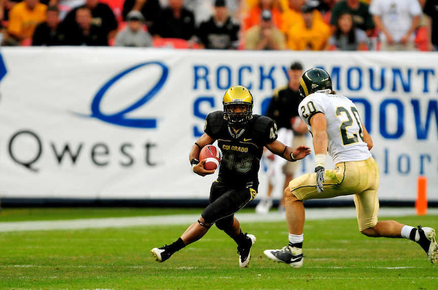 31 Aug 2008: Colorado tailback Rodney Stewart (43) tries to avoid a tackle by Colorado State defensive back Klint Kubiack (20). The Colorado Buffaloes defeated the Colorado State Rams 38-17 at Invesco Field at Mile High in Denver, Colorado. FOR EDITORIAL USE ONLY