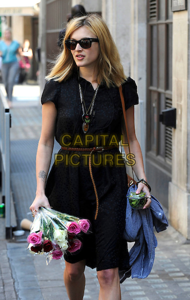 FEARNE COTTON.Leaving BBC Radio 1, London, England, UK, April 20th 2011..half length black shirt dress brown belt bag tan sunglasses bunch of flowers roses pink bouquet smiling edamame beans .CAP/IA.©Ian Allis/Capital Pictures.
