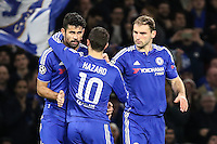 Diego Costa of Chelsea (left) is congralutated by Eden Hazard of Chelsea (2nd left) after his shot forced an own goal to give Chelsea the lead (1-0) during the UEFA Champions League group match between Chelsea and FC Porto at Stamford Bridge, London, England on 9 December 2015. Photo by David Horn / PRiME