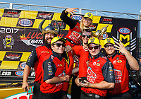Aug 20, 2017; Brainerd, MN, USA; NHRA top fuel driver Leah Pritchett is hoisted by her crew members as they celebrate after winning the Lucas Oil Nationals at Brainerd International Raceway. Mandatory Credit: Mark J. Rebilas-USA TODAY Sports